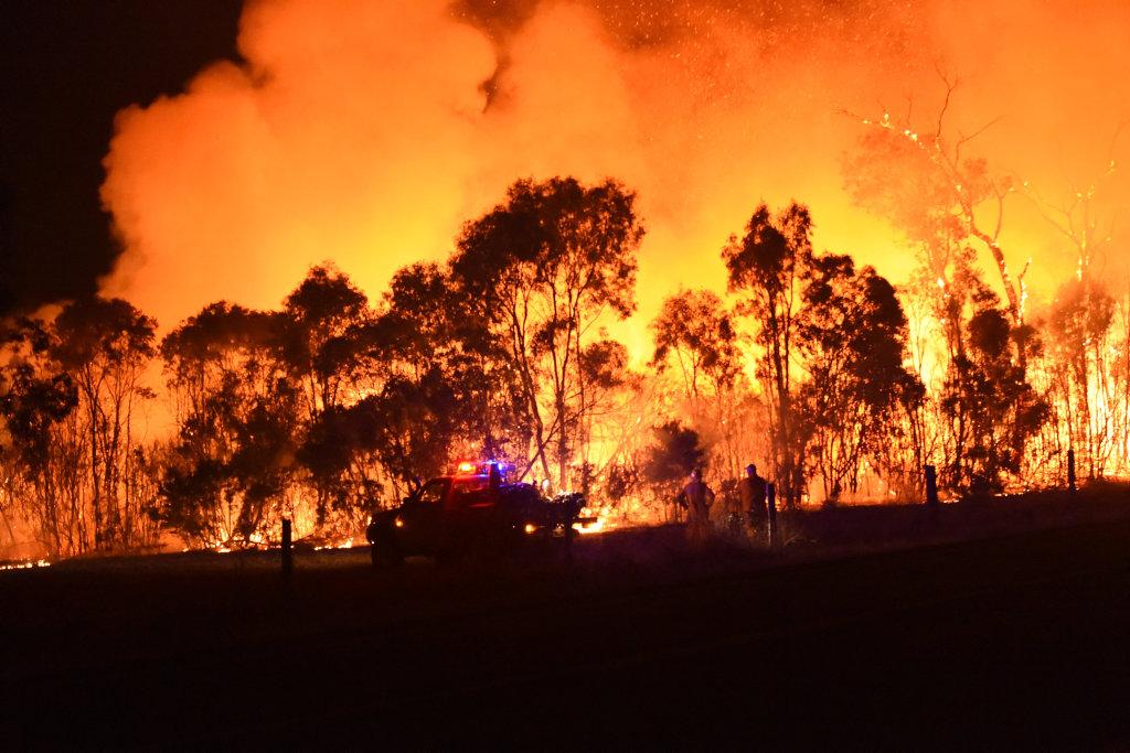 Firefighters battle a blaze at Burrum Heads Rd.