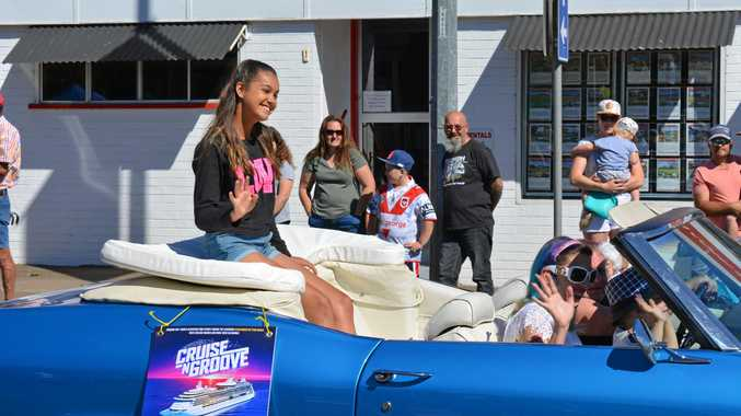 SMILE AND WAVE: The 2017 Laidley Spring Festival street parade rolled through Patrick Street on Saturday. Voice Kids Australia winner and Australia's 2016 Junior Eurovision representative Alexa Curtis waves to the crowd.