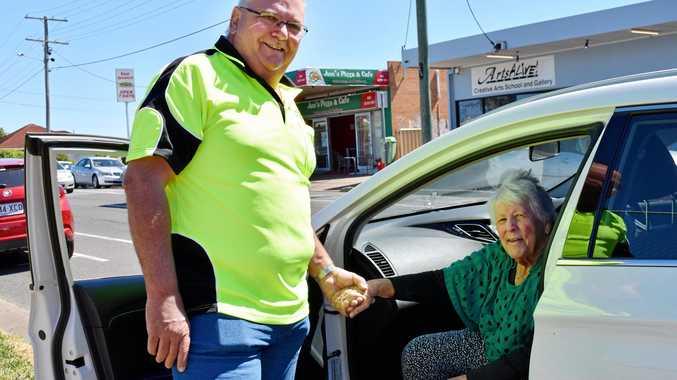 A HELPING HAND: Volunteer John Nipperess assists client Janice Diehm.