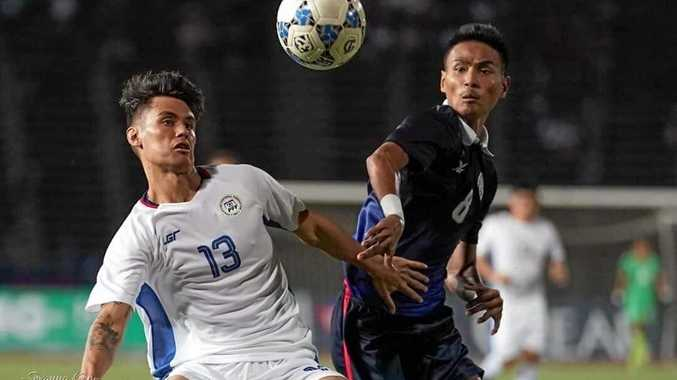 LIVING HIS DREAM: Joshua Grommen (white shirt) is playing soccer professionally in the Philippines.