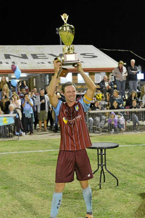 PROUD MOMENT: Brothers Aston Villa captain Josh McInnes holds the Wide Bay League trophy.