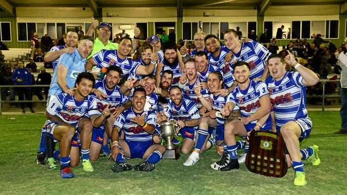 CHAMPIONS: Brothers Ipswich players celebrate their Reserve Grade title win.