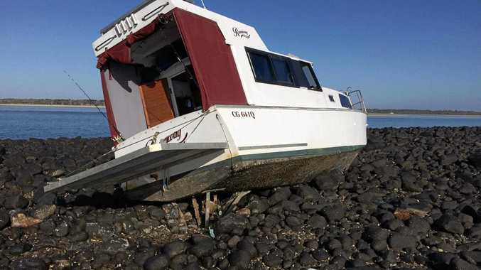 STUCK: A fishing boat ran aground at Dr May's Island, Elliott Heads at the weekend.