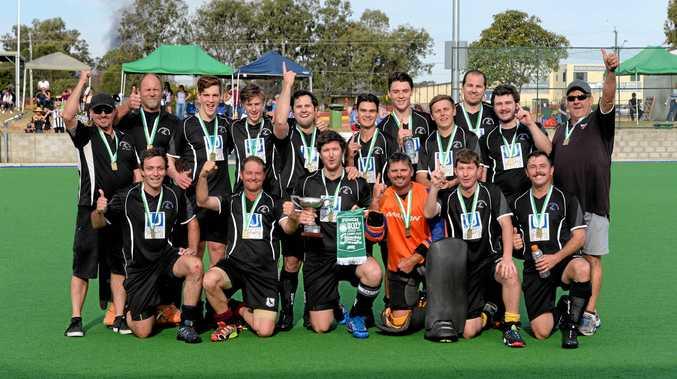 WINNING REWARD: The premiership-winning Wests' Reserve Grade hockey team enjoy their victory photo at Raceview on Saturday.