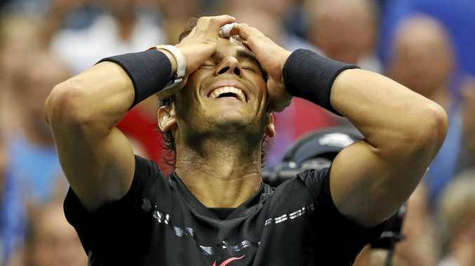 Rafael Nadal, of Spain, reacts after beating Kevin Anderson, of South Africa, to win the men's singles final
