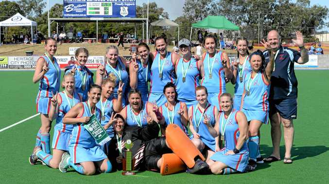 GREAT FINISH: The Swifts Reserve Grade hockey team unite to enjoy their latest grand final success.