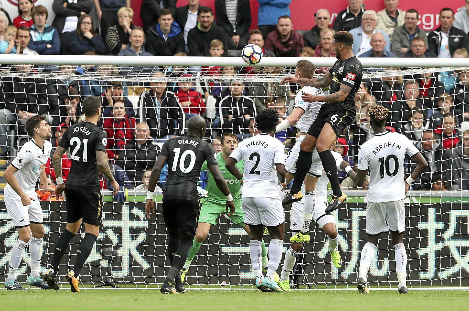 Newcastle United's Jamaal Lascelles, top right, scores against Swansea City in his side's 1-0 win.