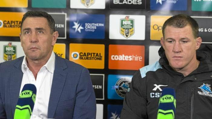 Shane Flanagan and Paul Gallen front the media after the Sharks' defeat.