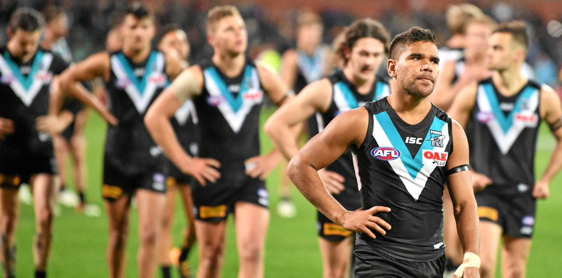 Port players after the first elimination final defeat to the West Coast Eagles at the Adelaide Oval.