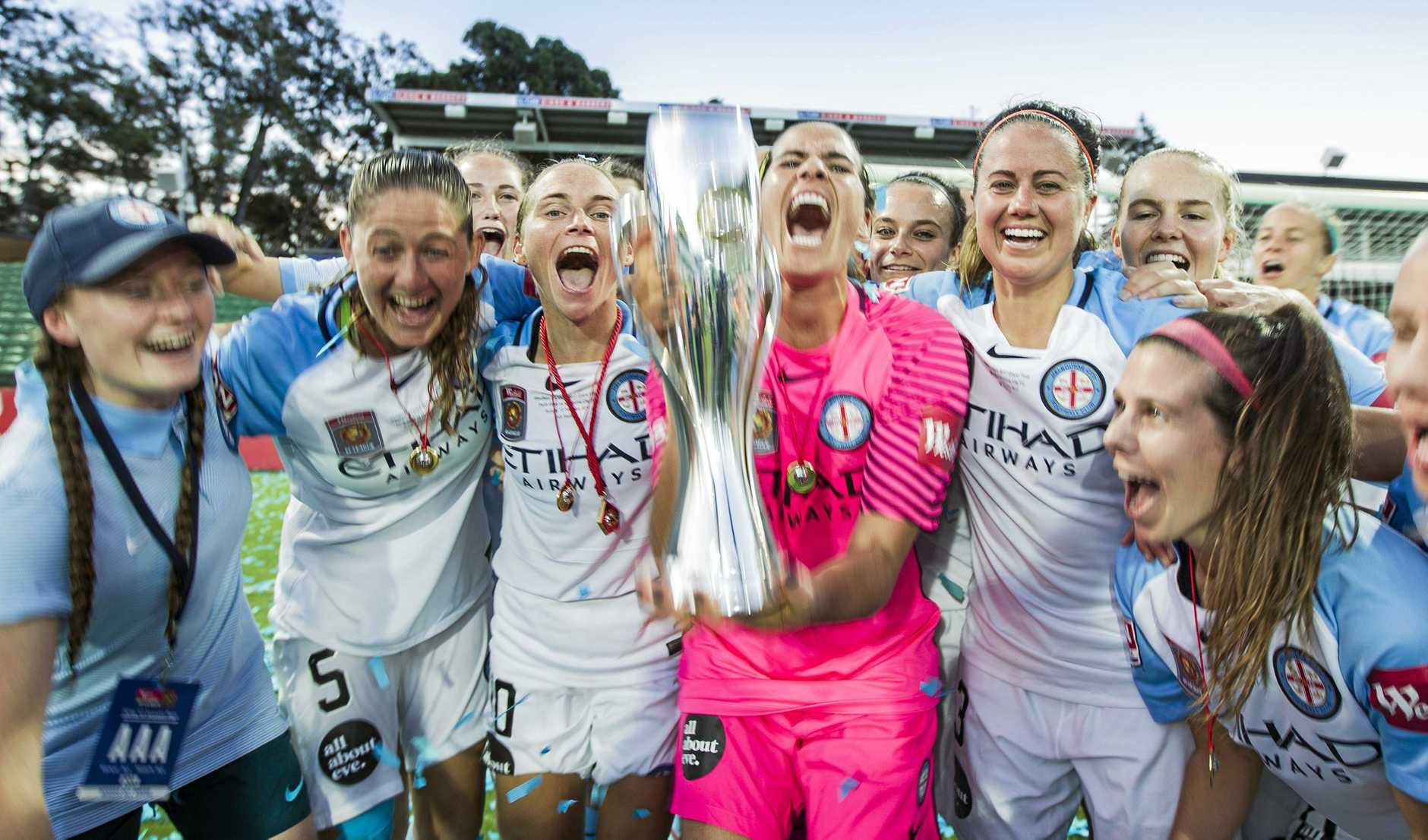 Melbourne City players celebrate their W-League win last season. Players will get a pay rise for this campaign.