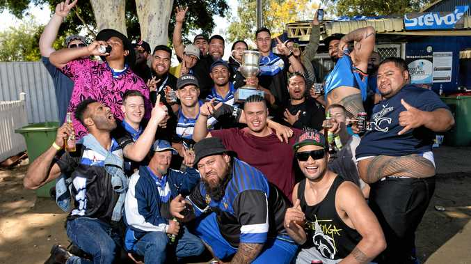 PARTY TIME: Goodna Eagles players and supporters celebrate back-to-back titles on Sunday at Woogaroo Field. The party was still going yesterday.