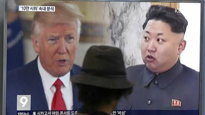 FILE - In this Aug. 10, 2017, file photo, a man watches a television screen showing U.S. President Donald Trump and North Korean leader Kim Jong Un during a news program at the Seoul Train Station in Seoul, South Korea. North Korea said Monday, Sept. 11, 2017 it will make the United States pay a heavy price if a proposal Washington is backing to impose the toughest sanctions ever on Pyongyang is approved by the U.N. Security Council this week. (AP Photo/Ahn Young-joon, File)