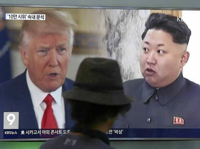 A South Korean man watches coverage of US President Donald Trump and North Korean leader Kim Jong Un during a news program at a Seoul train station.