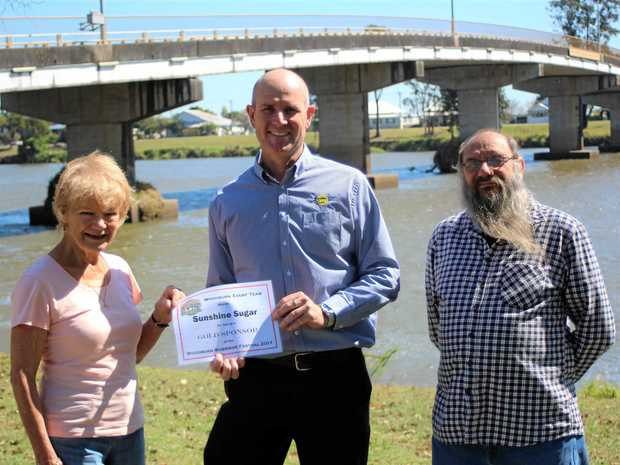 Sunshine Sugar received a Gold Sponsor Certificate of appreciation from Woodburn Riverside Festival organisers for sponsoring the event again this year. From left Pam Bellingham, David Wood and Glenn Crawford.