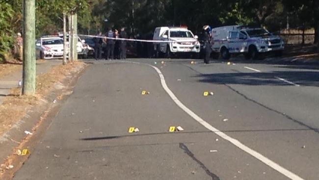 Police markers indicate rocks thrown on to the road.