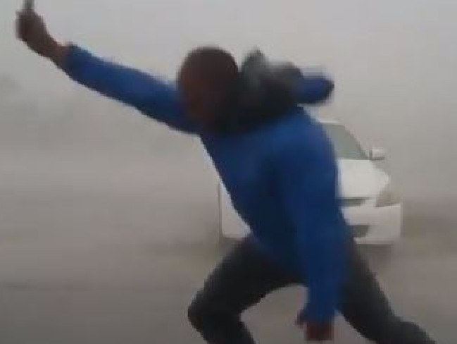 Juston Drake, a meteorologist taking the wind speed of Hurricane Irma in Florida.