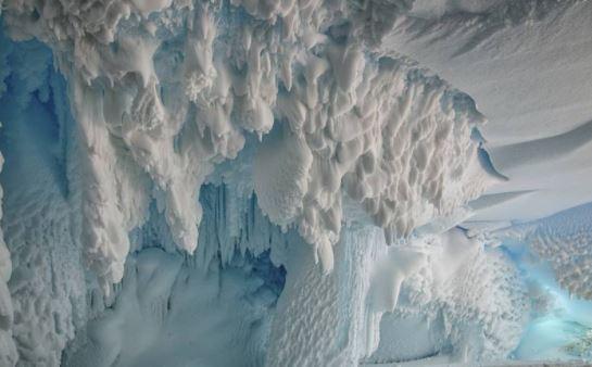 Inside an ice cave on the Erebus Glacier tongue, Ross Island, Antarctica, near Scott Base.