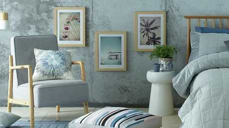 Assorted items from the new Aldi range, including the Tate arm chair in grey.Source:Supplied