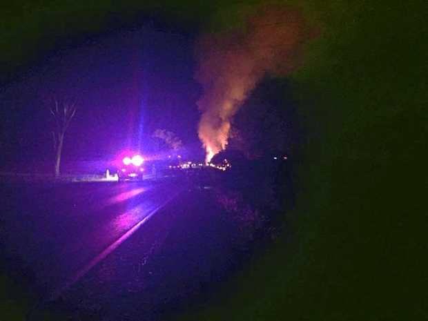 A car was engulfed in flames after crashing on the Bruce Hwy overnight.
