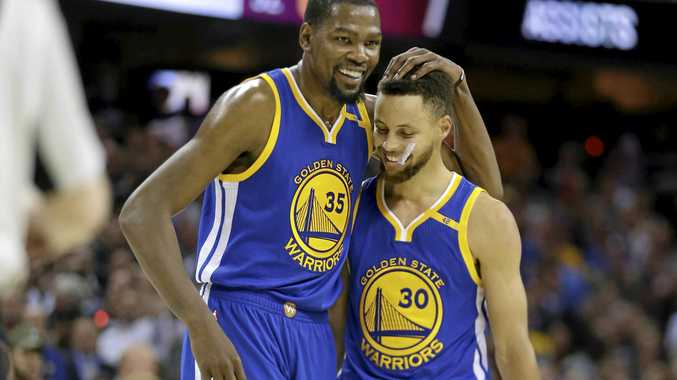Golden State Warriors teammates Kevin Durant (left) and Steph Curry.