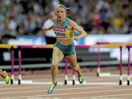 Australia's Sally Pearson crosses the finish line to win the women's 100m hurdles at the world championships in London.