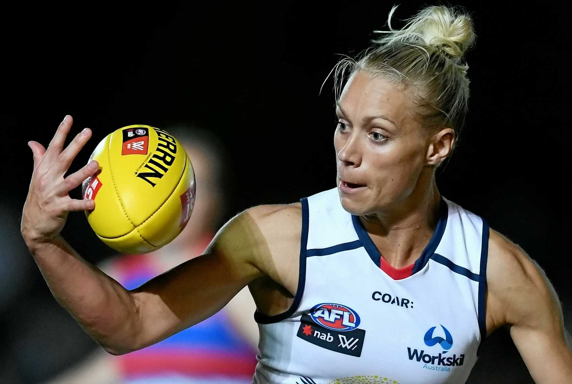 Erin Phillips of the Crows in possession during the round 2 AFLW match between the Adelaide Crows and the Western Bulldogs and Whitten Oval in Melbourne,  Friday, Feb. 10, 2017. (AAP Image/Tracey Nearmy) NO ARCHIVING, EDITORIAL USE ONLY