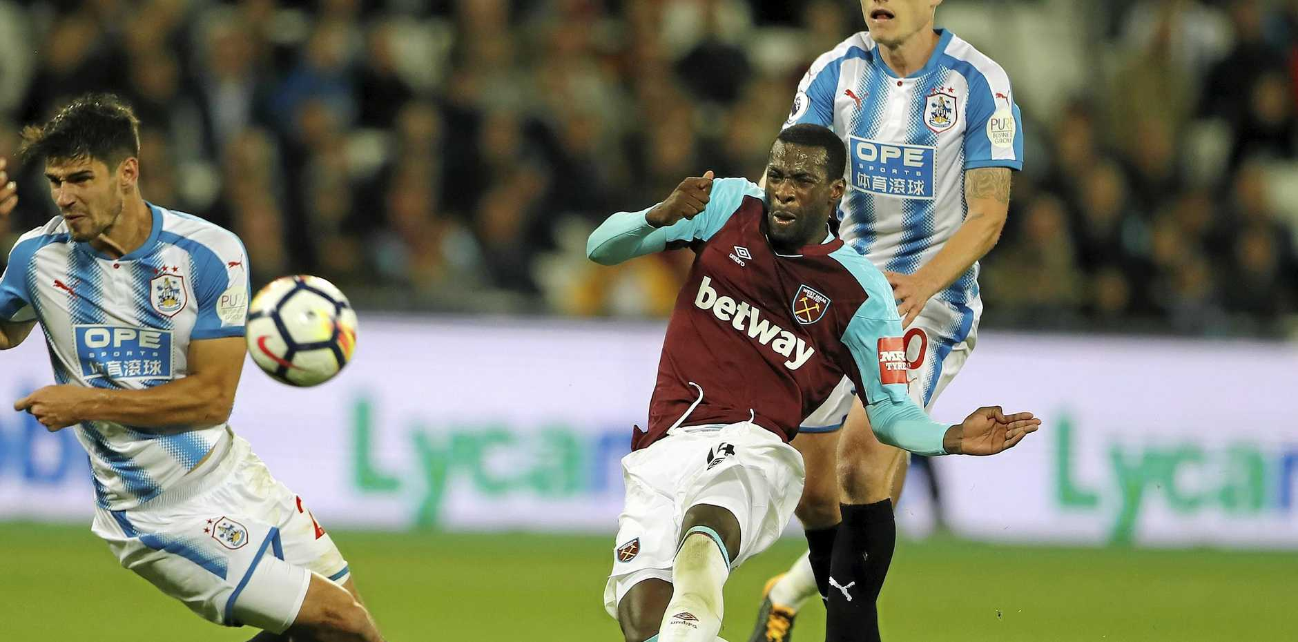 West Ham's Pedro Obiang shoots to score his side's first goal against Huddersfield.