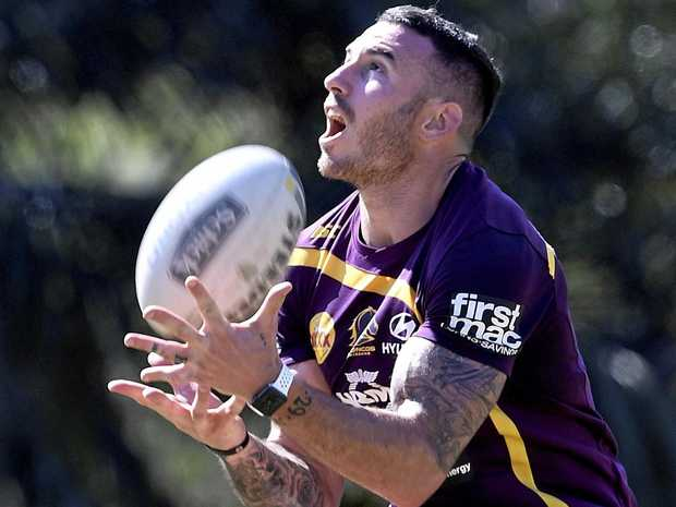 Darius Boyd catches a high ball during a fitness test at the Broncos' training session.