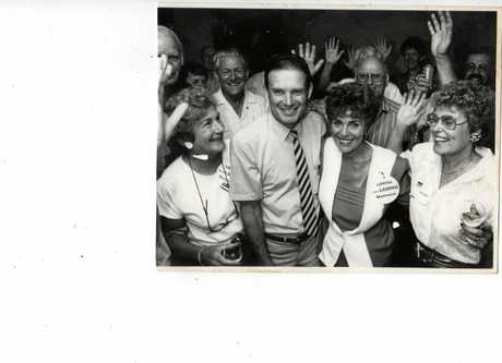 BRUCE Laming and wife Estelle(centre) celebrate an early election win with supporters.