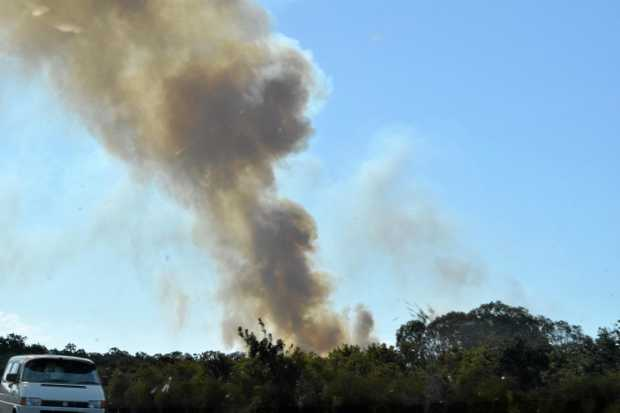 Smoke could be seen kilometres away after a fire in Burrum Heads burned out of control.
