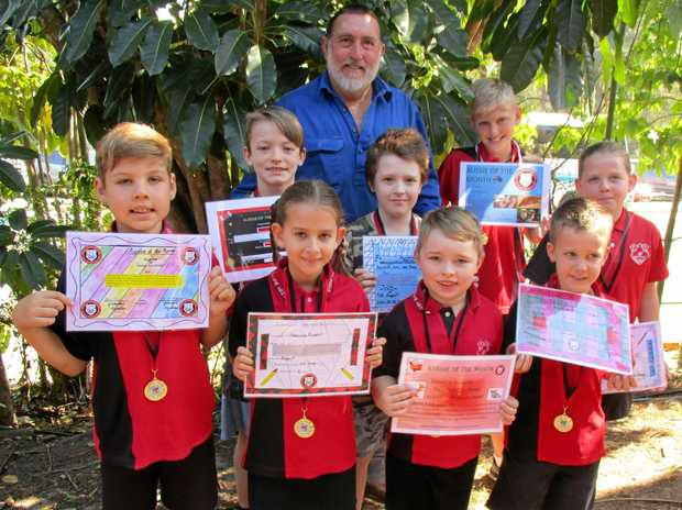 OUTSTANDING: Gympie West's Aussies of the Month are: (Back from left) Mr Andy Troy and Jamie Wessels, (Middle) Talon Fordham, Blake Taylor, Locklan Chalmers and Vanessa Boyd, (Front) Marcella Kendall, Ryan Gilbert and Eamon Francis.