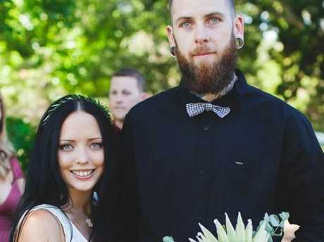Caity Fitzgerald and her husband Chris on their wedding day. Picture: Tyra Gunnis