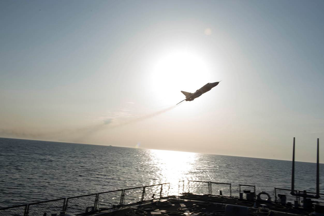 In this Tuesday, April 12, 2016 photo provided by the U.S. Navy, a Russian Sukhoi Su-24 attack aircraft makes a low altitude pass by the USS Donald Cook in the Baltic Sea. U.S. officials said the guided-missile destroyer was operating in international waters 70 nautical miles off the Russian enclave of Kaliningrad. (U.S. Navy via AP)