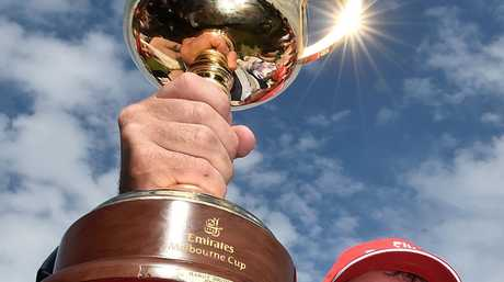Darren Weir, Prince of Penznace's trainer, holds the 2015 Melbourne Cup.