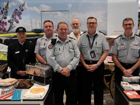 Toowoomba LAC's Vince Little, Officer in Charge of Toowoomba Ambulance Station Peter Baron, OIC Highfields Ambulance Station Derrick Scheuer, Pioneer Village's Chris Kusay, Darling Downs Acting Executive Manager of Operations Stephen Johns and Darling Downs Acting Assistant Commissioner Glen Maule at the Ambulance Week display in Grand Central this week.