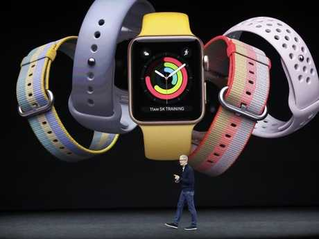 Apple CEO Tim Cook shows off the new Apple Watch. Picture: AP