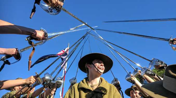 JOIN US: Members of the NSW Australian Army Cadets draw swords at the final parade after completing the brigade courses at Singleton Army Base.