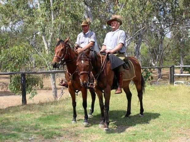 SADDLE UP: Howard Weier (right) and David Britten in their original summer uniforms and saddled up will celebrate the 100 year anniversary of The Battle of Beersheba in Israel in October.