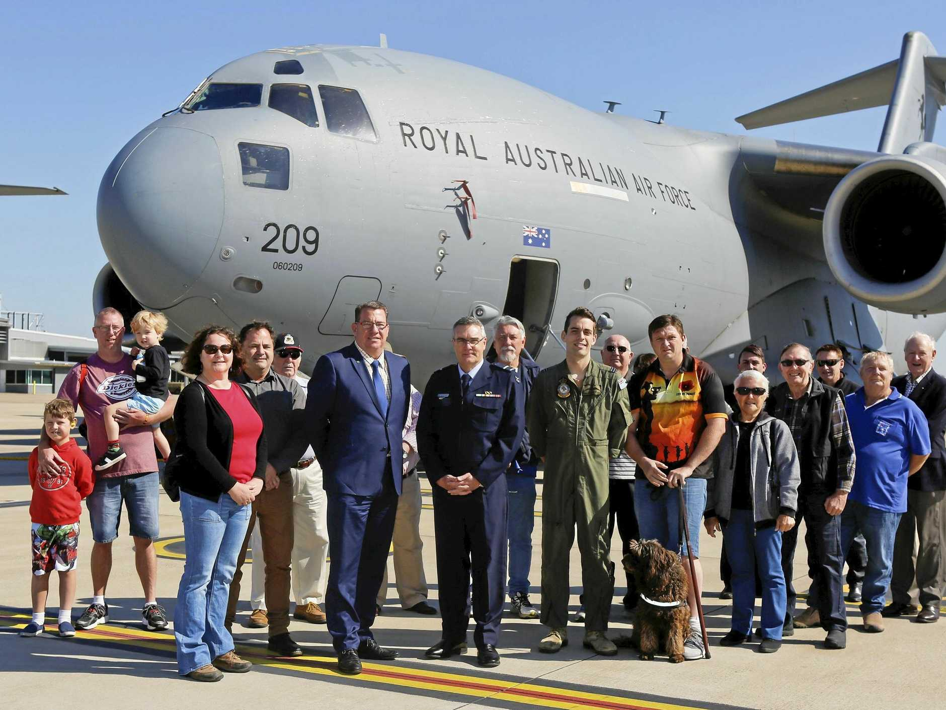 UP CLOSE: Senior Australian Defence Force Officer, Air Commodore Kenneth Robinson, CSC, Federal Member for Wright Mr Scott Buchholz MP and members of Veterans Support Centre with a C-17 Globemaster during their visit to No. 36 Squadron.