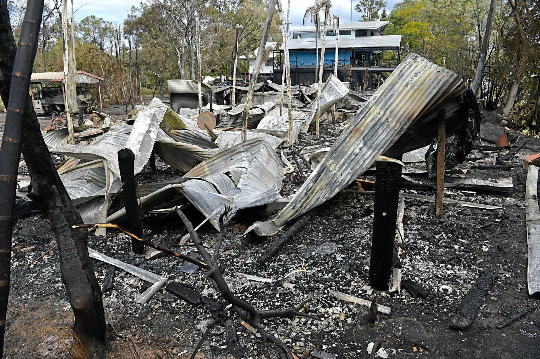 Fire has destroyed three homes on Noosa North Shore.