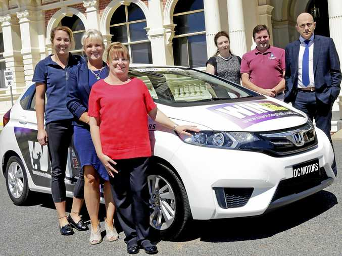 The Vega Vega Garcia Team: (Front) Meg Tweed, Cher Roberts and Merri Anderson (Back) Dr Debora Garcia, Anthony Warby and Antonio Vega Vega with the Honda Jazz being raffled as part of the Black Dog Ball's 2017 fundraising initiatives.