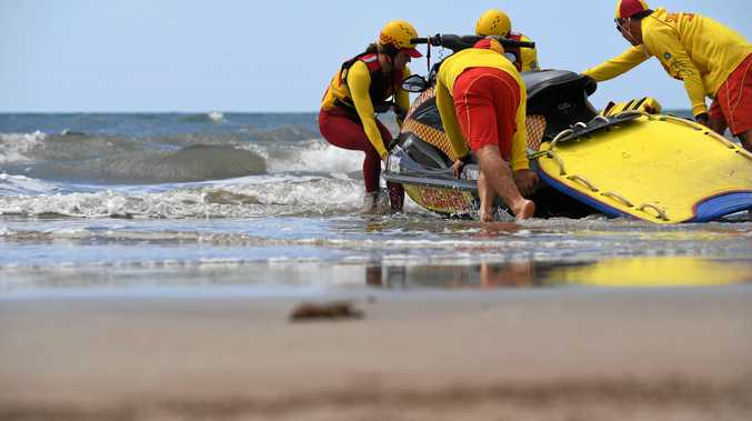 RED AND YELLOW: Surf lifesavers launch a jet ski at Nielson Park Beach ahead of the start of the season.
