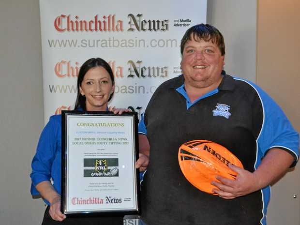 BIG WIN: Chinchilla News' Bobbie Gorring with footy tipping winner Clinton Smith.