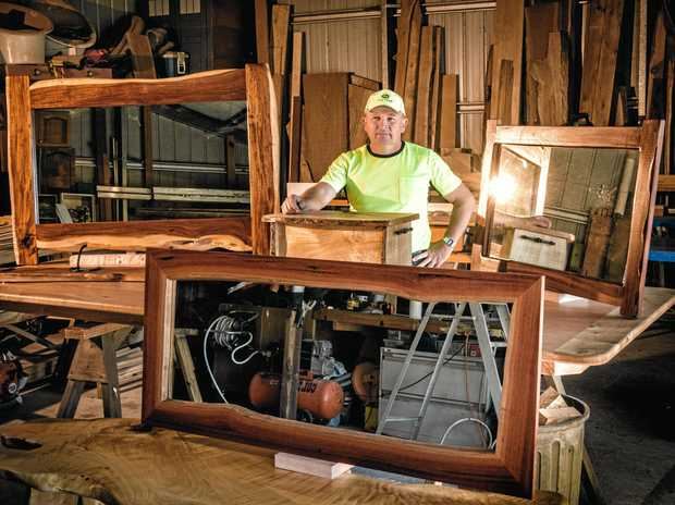 Norman Gray in his workshop at Gulmarrad with some of his woodworking handiwork.
