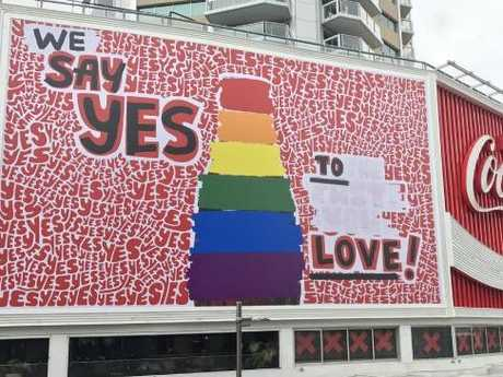 The famous Sydney Coca-Cola sign undergoing its rainbow transformation on Tuesday.Source:Supplied