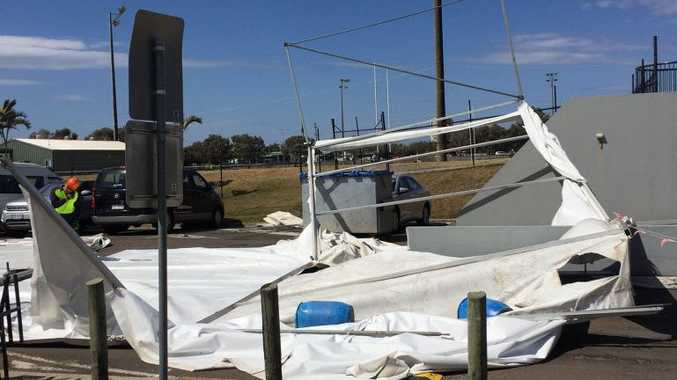 DAMAGED: The tent which was whipped up by the winds at Sunshine Coast Stadium today.