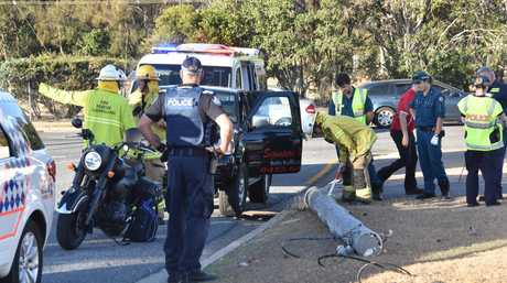 LINES DOWN: Fire fighters and paramedics attended the scene of a single vehicle crash which brought down a power pole at a Barney Point intersection.