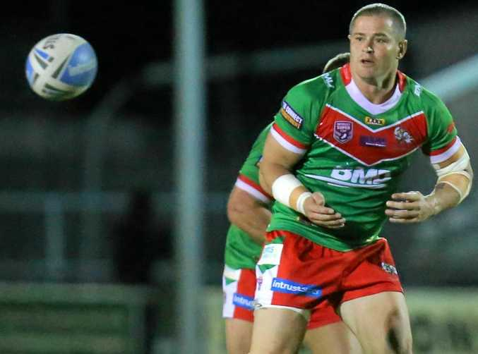 HE'S BACK: Travis Burns passes for Wynnum Manly Seagulls in his final season in the big league.