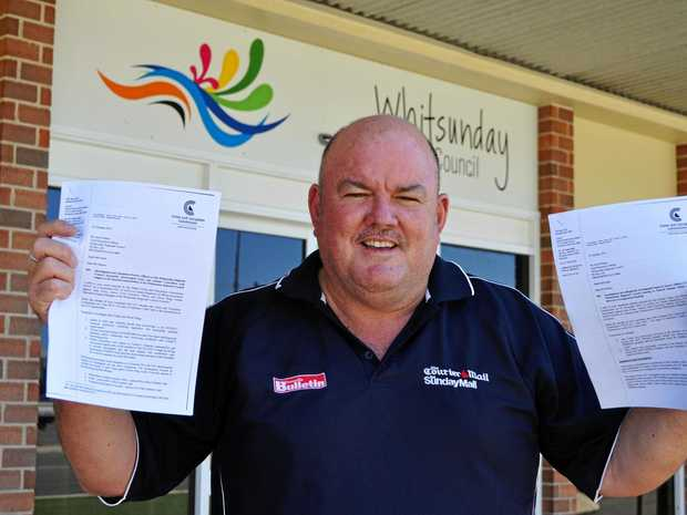 Cr Mike Brunker with copies of the Crime and Corruption Commission documents now available on the Whitsunday Regional Council's website.