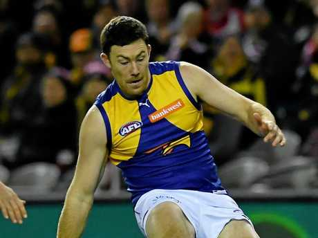 Jeremy McGovern of the Eagles scores a goal.